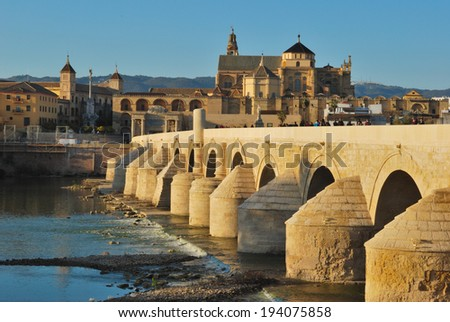 Cordoba  mosque seen from Roman bridge, Andalusia, Spain - stock photo