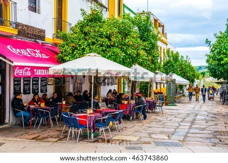 CORDOBA, SPAIN, JANUARY 8, 2016: view of the small square Plaza del potro in the spanish city cordoba, which is surrounded by many restaurants, tourist shops and an ancient fountain.