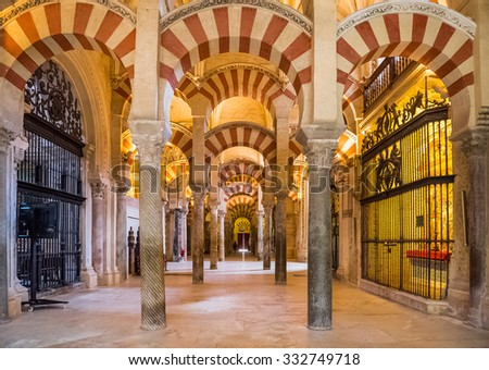 CORDOBA, SPAIN - JUNE 4: Interior view of La Mezquita Cathedral on June 4, 2014 in Cordoba, Spain. The cathedral was built inside of the former Great Mosque. Popular tourist destination in Spain.  - stock photo