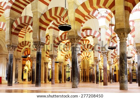CORDOBA, SPAIN - MARCH 12, 2013: Interior of The Great Mosque of Cordoba (La Mezquita) -  masterpiece of moorish architecture, 11th century - stock photo