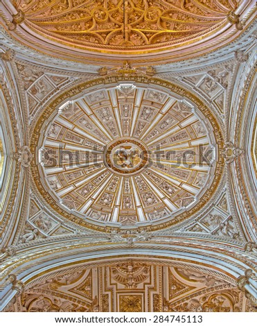 CORDOBA, SPAIN - MAY 28, 2015: Cupola of The Main chapel of The Cathedral by Juan de Ochoa from 16. cent. with the gothic and baroque vault .