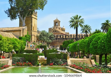 CORDOBA, SPAIN - MAY 16: Gardens of Alcazar de los Reyes Cristianos on May 16, 2012 in Cordoba, Spain. Alcazar has 55,000 square meters of gardens full of vegetation surrounded by fountains and ponds - stock photo