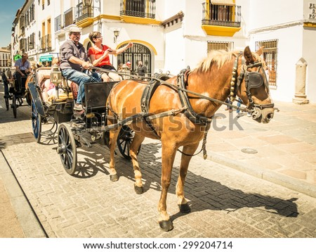 CORDOBA, SPAIN - MAY 08: horse carriage on May 08, 2015 in Cordoba, Spain. The historic centre was named a UNESCO World Heritage Site. - stock photo