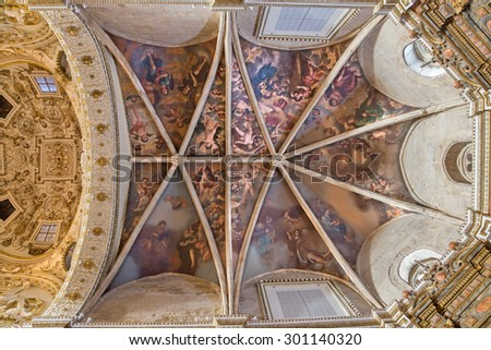 CORDOBA, SPAIN - MAY 26, 2015: The ceiling of presbytery in church Iglesia de San Augustin with the fresco of angels from 17. cent. by Cristobal Vela and Juan Luis Zambrano. - stock photo