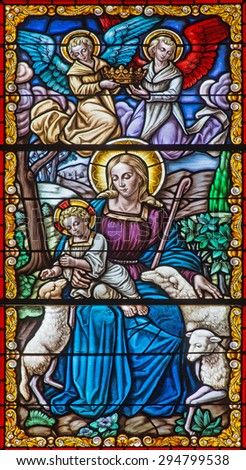 CORDOBA, SPAIN - MAY 27, 2015: The Madonna with the child among the sheps on the windowpane in church Convento de Capuchinos (Iglesia Santo Anchel). - stock photo