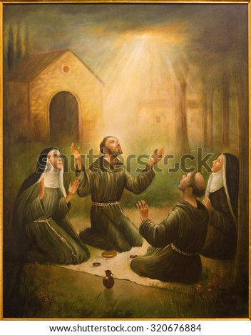 CORDOBA, SPAIN - MAY 27, 2015: The St. Francis of Assisi and St. Clara at prayer in front of Porziuncola in church Convento de Capuchinos (Iglesia Santo Angel). Paint from 20. cent. by unknown artist - stock photo