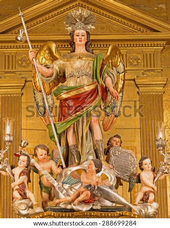 CORDOBA, SPAIN - MAY 27, 2015: The statue of archangel Raphael on the main altar in Basilica del Juramento de San Rafael by sculptor Alfonso Gomez de Sandoval from 18. cent. - stock photo