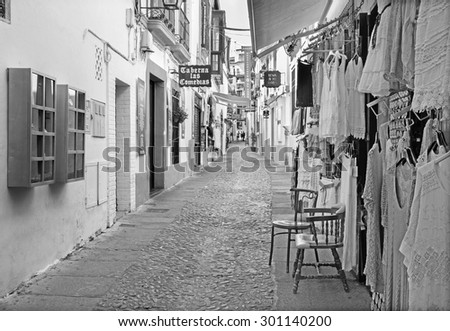 CORDOBA, SPAIN - MAY 26, 2015: The street Velasques Bosco with the little shops and bars. - stock photo