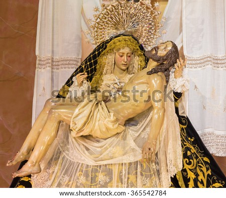 CORDOBA, SPAIN - MAY 26, 2015: The traditional vested Lady of Sorrow statue (Pieta) in church Iglesia de San Augustin from 19. cent. - stock photo