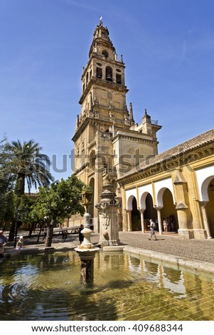 CORDOBA, SPAIN - September 10, 2015: The Bell Tower seen across a fountain in the Courtyard of the Orange Trees of the Mosque-Cathedral of Cordoba, on September 10, 2015 in Cordoba, Spain - stock photo