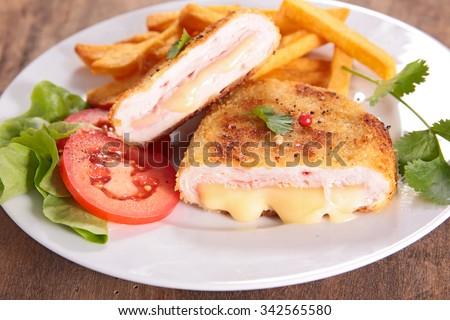 cordon bleu and french fries - stock photo