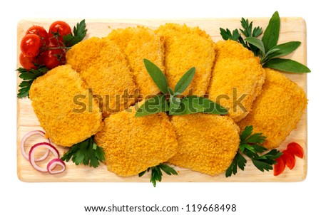 Cordon bleu on wooden board - stock photo