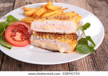 cordon bleu with french fries - stock photo