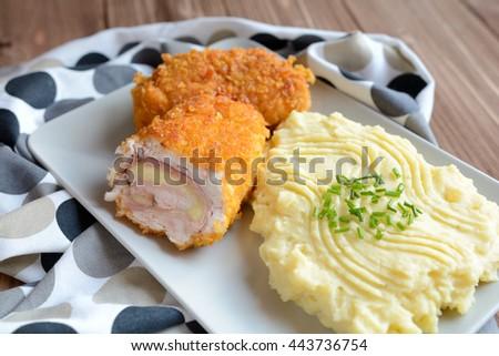 Cordon bleu with mashed potatoes - stock photo