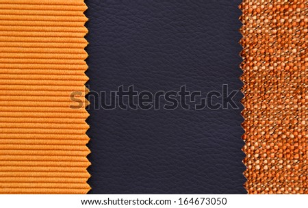 Corduroy and leather texture in black and orange colors - stock photo