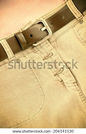 Corduroy skirt with leather belt sepia image. - stock photo