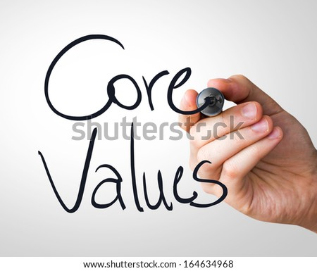 Core Values hand writing with a black mark on a transparent board - stock photo