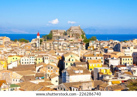 CORFU-AUGUST 22:Corfu cityscape with the Saint Spyridon Church bell tower in the distance seen from the New Fortress on August 22, 2014 on Corfu island, Greece. - stock photo