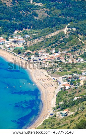 Corfu beach coastline birds eye view. Typical sandy beach found in Kerkyra island. - stock photo