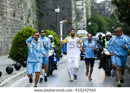 Corfu, Greece - April 23, 2016: Athletes carrying the Olympic Flame on the Torch Relay leg for the Rio 2016, from city to city in Greece
