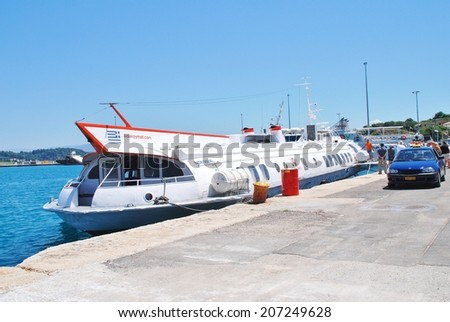 CORFU, GREECE - JUNE 23, 2014: Joy Cruises hydrofoil Ilida II disembarks passengers from Paxos at Kerkira harbour on the Greek island of Corfu. The 35mtr long vessel was built in Georgia in 1982. - stock photo
