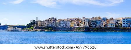 Corfu island panorama from the sea. Old town buildings of Kerkyra island - stock photo