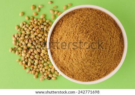 coriander seeds and coriander powder - stock photo
