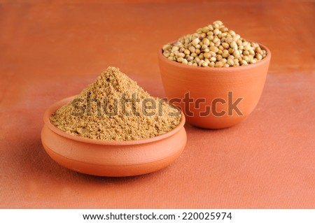 coriander seeds with powder - stock photo