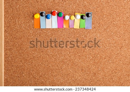 Cork board and colorful heading with copyspace for a ten letter word  - stock photo
