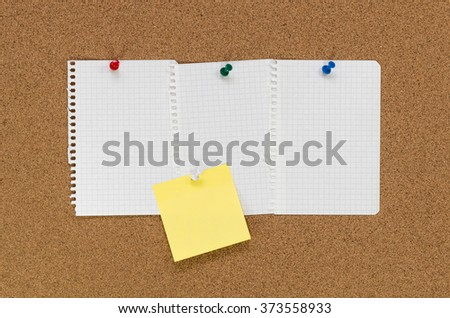 Cork board and note papers, close up image