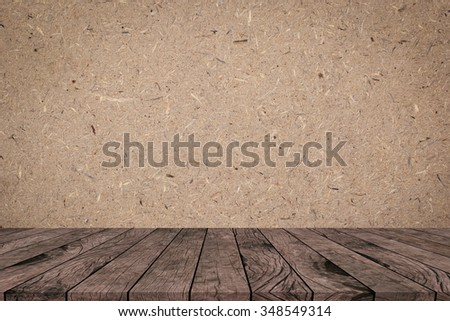 Cork board background with aged brown wooden panel perspective view. - stock photo