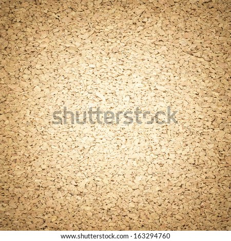 Cork board background with light center - stock photo