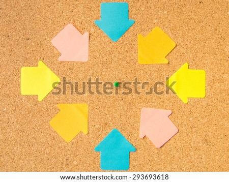 cork board pin pointed arrows - stock photo