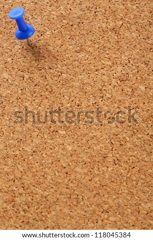 Cork board with blue pin on left top - stock photo