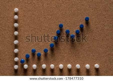 Cork board with blue pins - stock photo