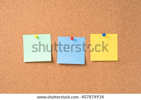 Cork board with colorful blank notes - stock photo
