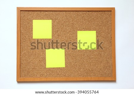 Cork board with paper note placed on white background