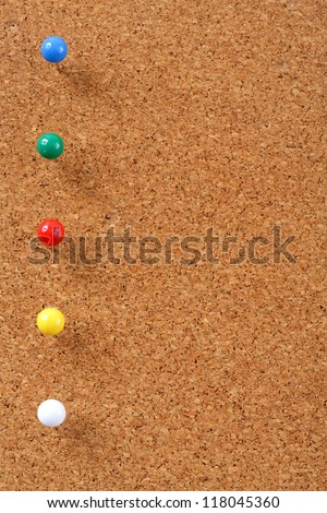 Cork board with pins bullets
