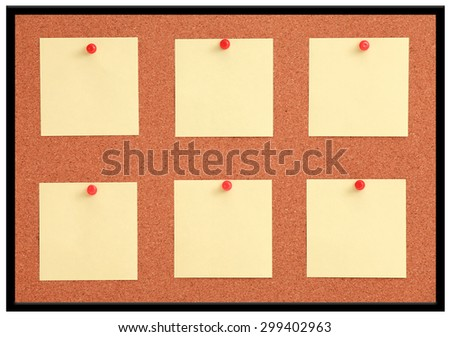 Cork board with six yellow notes and red pins