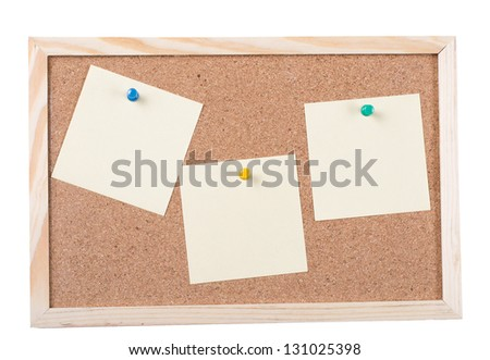 Cork board with sticky notes pinned isolated on white background.