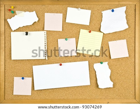 Cork bulletin board with blank notes. - stock photo