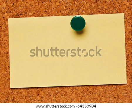 Cork bulletin board with note - stock photo