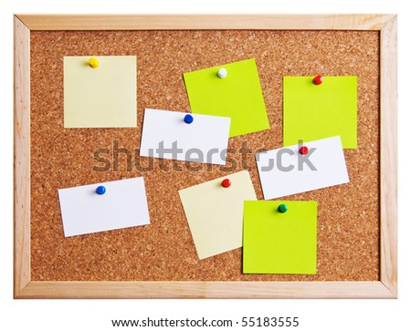 Cork bulletin board with notes and business cards. - stock photo