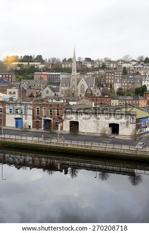 Cork city buildings beside the river Lee in Ireland - stock photo