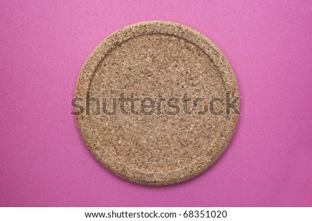 Cork Coaster on a Vibrant Pink Background. - stock photo