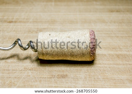 Cork from wine on the downward spiral are lying on a wooden surface,macro - stock photo