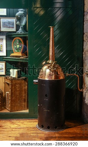 CORK, IRELAND - JUNE 20, 2008:  Home small copper whiskey distillery at the Jameson Heritage Center  in Midleton Co. Cork, 12 miles east of Cork City on the main Cork Waterford Road.  - stock photo