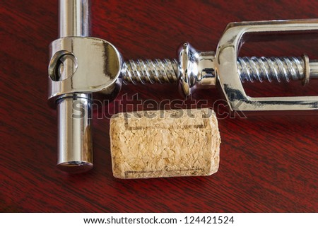 cork with corkscrew and the wine accessories - stock photo