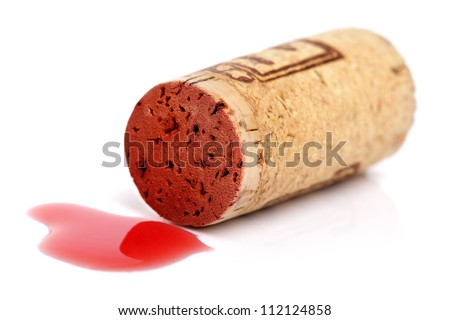 Cork with spilt red wine isolated on white - stock photo