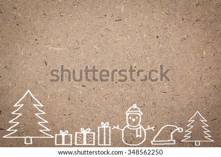 cork wooden background with handwritten adorable doodle of Christmas festival celebration decorate.space board with doodle cartoon of xmas day concept.display picture with vignette style.  - stock photo